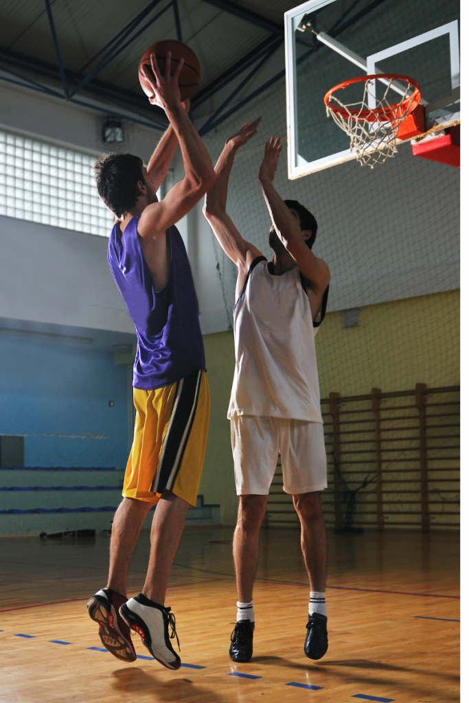Two Teen basketball players struggling for the ball