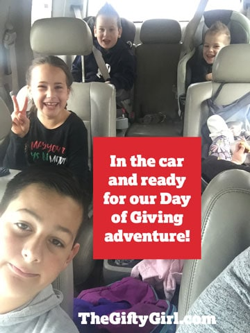 Kids in the car ready for our fun family Christmas Tradition!