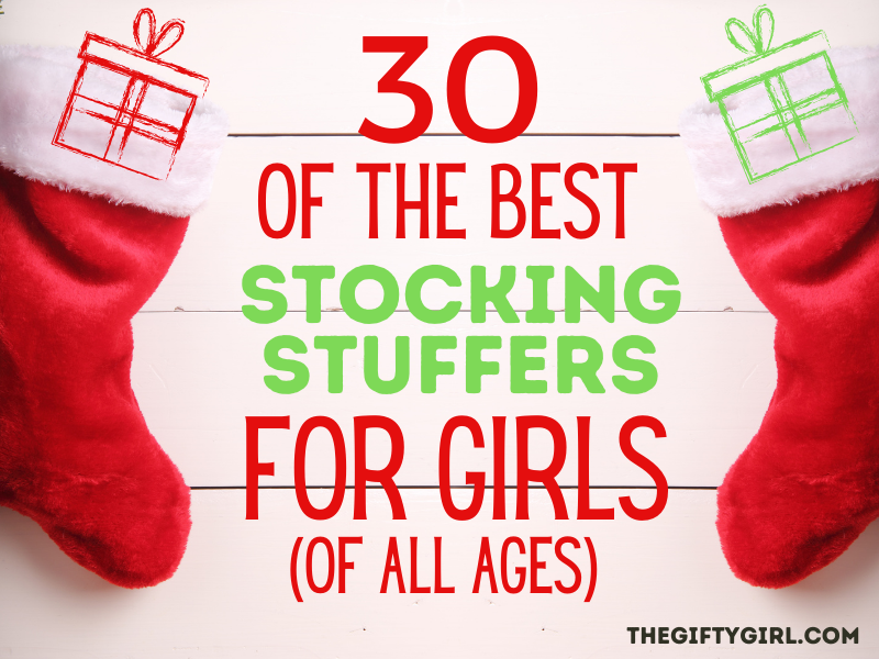 "Two red Christmas stockings on white wooden boards. Each stocking has an illustration of a gift. Text overlay says ""30 of the best stocking stuffers for girls of all ages"" TheGiftyGirl.com"
