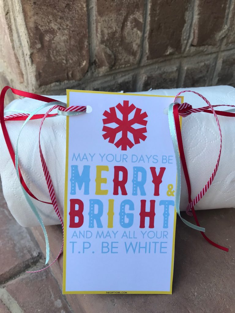 close up photo of two toilet paper rolls with ribbons and a gift tag Christmas Neighbor Gift for 2020