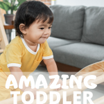 A toddler boy in a yellow romper is climbing up a Pikler arch with a small smile on his face. Text overlay says 15 amazing toddler climbing toys thegiftygirl.com
